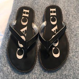 Coach black leather flip flops
